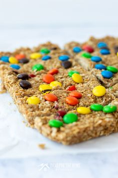 Treat your kids to an easy homemade snack after school. These no-bake granola bars with M&Ms, oatmeal and peanut butter are delicious and simple to make. Easy Homemade Snacks, No Bake Granola Bars, Peanut Butter Cup Cookies, Oatmeal Recipes, Mini Chocolate Chips, Afternoon Snacks, Salted Butter, Kid Friendly Meals, Dessert Ideas