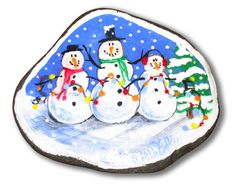 painted rocks images | These three snowmen are surrounded by falling snow and a Christmas ...