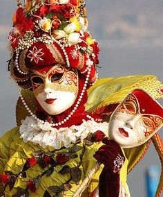 Venice ~ Carnival/ Love the hand held mask that matches the face! G.