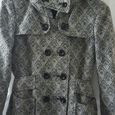 Hooded wool coat 55%polyester 26%acrylic 13%wool 2%rayon  Lining is 100%polyester  Dry clean only Jackets & Coats Pea Coats