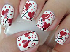 white nails with hot red hearts