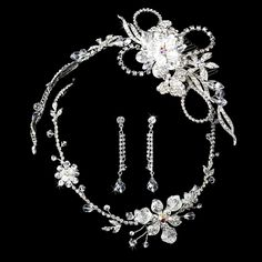 Eye-catching and elegant, the Floral Swarovski Matching Tiara & Jewelry Set features a floral design crafted with Swarovski crystals and rhinestones, and several trios of opal rhinestones at the center of the flowers. http://www.elegantbridalhairaccessories.com/shop/matching-tiara-jewelry-sets/floral-swarovski-matching-jewelry-set/