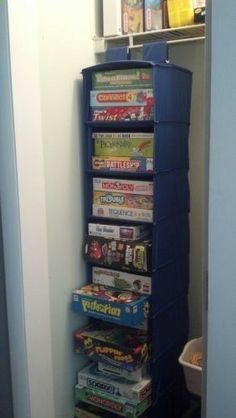 Store and organize board games in a hanging shoe organizer. Perfect...I already have one of these!