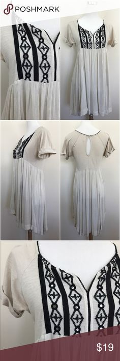 "Free People Cream Embroidered Dress India Boho dress with black embroidery, mirrors, and high-low hem. Good condition. There are some snags in the skirt, see close up photos.   M E A S U R E M E N T S Armpit to armpit 17.5"" Waist 17"" flat Hips 30"" flat Length 32"" shoulder to front bottom hem Free People Dresses High Low"