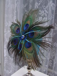 Peacock Flower  www.tablescapesbydesign.com https://www.facebook.com/pages/Tablescapes-By-Design/129811416695