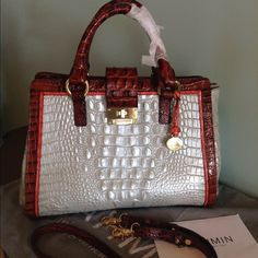 Brahmin Annabelle Tri-Color Satchel NWOT  Brahmin is way ahead of the pack in the design of the perfect structured satchel & Annabelle is one of the most ELITE styles ! She's totally feminine with gorgeous colors in Cream , Gold , Pecan & Coral Trim! Beautiful Leather & Stitching plus snaps on the side to expand the interior space ! Lg. slide in pocket in the back plus solid brass hardware , zip jewelry pocket , 2 organizer pockets, key clip & pen loops plus Registration Card & dust bag…