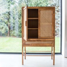 Perfectly combining function and form for a statement look, our Avery cabinet is crafted from natural blackened mango wood with a seventies-inspired cane webbed front. Unusual Furniture, Eclectic Furniture, Furniture Styles, New Furniture, Rattan Peacock Chair, Rattan Rocking Chair, Swinging Chair, Bamboo Shelf, Bamboo Wall