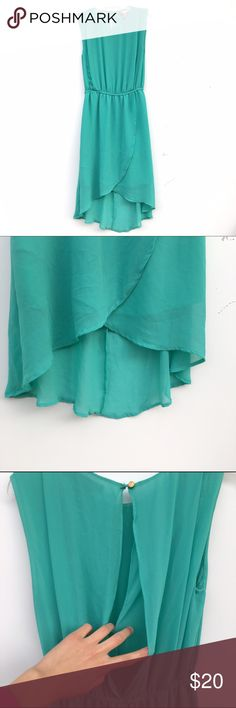 High-Low Sleeveless Turquoise Dress Turquoise and sleeveless high-low dress. Has a double slit keyhole in back. Waist is slightly cinched. Dresses High Low