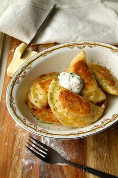Potato and aged cheddar perogies,  looks amazing,  serve with caramelized onions and sour cream.