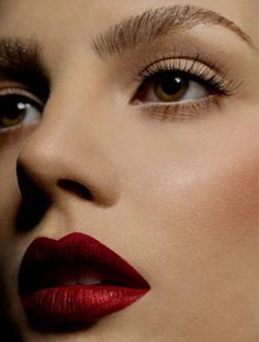 Deep red lips and subtle eyes