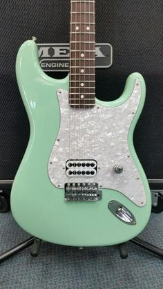 For sale is a custom built Tom DeLonge USA Stratocaster. This guitar was made with genuine Fender parts and assembled by our master technicians. The stratocaster is made to exact specs of Tom DeLonge's Stratocasters which includeSeafoam Green USA Fender BodySingle Seymour Duncan Invader PickupWhi...