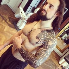 Nordic tattoo complete with viking hair and beard haha