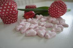 Pink heart-shaped meringues