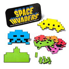 Space Invaders Fridge Magnets. I would get a mini-fridge for my room just for these magnets.