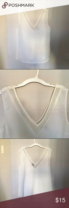 White v-neck detail mesh tank blouse Brand: Forever 21. Size medium. Super cute and simple. Perfect for layering or wearing by itself! NO SWAPS. #white #forever21 #vneck #mesh #tank #blouse   Fun fact: I discount bundles! :) Forever 21 Tops Tank Tops
