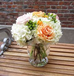 H.J. Benken's Centerpiece with Hydrangeas, Ranunculus, Hypericum and Garden Roses by Benkens.com