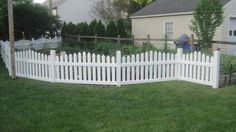 PRIZM VINYL FENCES Style: Scranton Color: White (used around a vegetable garden)