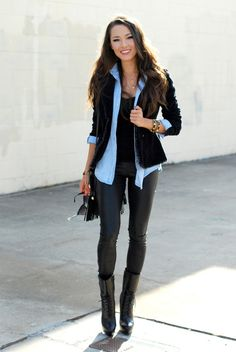 I like how the denim shirt is layered over a black T and under a black blazer. Not so sure about the pants or the boots, but I love the layering on top.