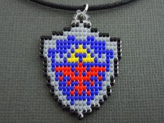 Hylian Shield Necklace, Seed Bead, Video Game Jewelry, Handmade, Pixelated, Nintendo, Legend of Zelda, 8 Bit, Gamer, Miniature Pixel Art