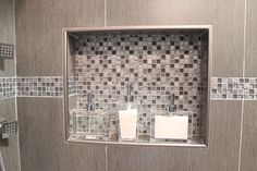 Double shower niche witn metal trim and decorative glass accent tile Tile Shower Niche, Bathroom Niche, Shower Tile Designs, Bathtub Shower, Diy Shower, Small Bathroom, Bathroom Ideas, Frameless Shower, Shower Door