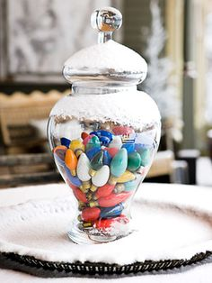 Got some extra Christmas lights? Place them in a glass apothecary jar to make a colorful centerpiece. #decorations