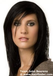 This luxuriant ink black hair has been created in long layers and a selective side part that brings the hair over the top in smooth blends, to meet the other layers. We can see the dimension of the top by the few wisps that lie over her eye. Use gel and smoothing lotion for this hairstyle.