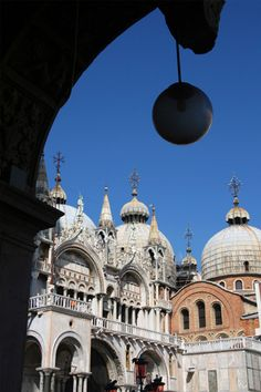 An opulent synthesis of Byzantine and Romanesque styles, Venice's gem, Saint Mark's Basilica, is laid out in a Greek-cross floor plan and topped with five plump domes.