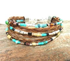 Bohemian Cowgirl Multi-Strand Beaded Horsehair Bracelet at www.nomadearthdesigns.etsy.com, makes a great #christmasgift for any #horse #loving #equestrian while helping #rescuehorses.