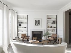 Nicholas Schuybroek's clean, minimal design for this Paris apartment emphasizes natural light and adopts a restrained approach to finishes. The L'Oeil coffee table is by Pierre Chapo and the pair of armchairs are by Pierre Jeanneret.
