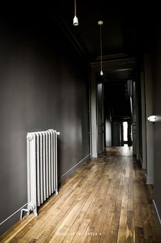 Parquet / dark grey hallway / old dark grey radiator -★- Home / Work in progress / Interior design & Photography by Nicolas Valla #darkhallwayideas