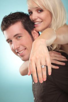 photography poses couples | Woman Jumping On Man's Back Showing Off Her New Engagement Ring