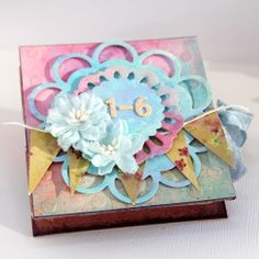 """Learn how to make a cute little mini album from one sheet of 12"""" x 12"""" paper. Then decorate with extra fun embellishments."""