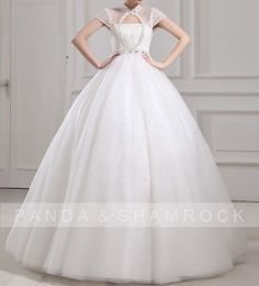 I really dig the cap sleave bolero attached to this wedding dress. Even better,  it doesn't have a sweetheart neckline. ♥ Simple,  Elegant.