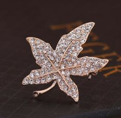 Min.order is $15 (mix order)-Korean Fashion Maple Leaf Crystal Brooch-Y091 Rated 5.0 /5 based on 1 customer reviews  100.0% of buyers enjoyed this product! (1 votes) 3 orders Price: US $2.08 / piece Bulk Price