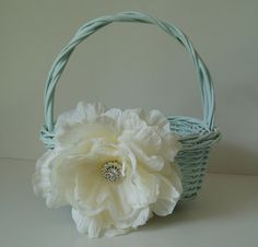 Flower Girl basket. So cute and easy to diy!  We could spray paint a basket black and add a deep red flower to the side with a big rhinestone center.  @Vanessa Samurio Samurio Venegas