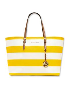 Shine bright with this sunny striped bag by Michael Kors ($328 at michaelkors.com).