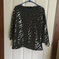 "Gray sweater with sequins Beautiful gray sequined top, 97% polyester 3% spandex. Only worn once, no sequins missing, as new condition. Boat neck, 3/4 length sleeves, approx 27"" long. Alex Marie Tops"
