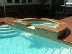 Custom Spillover Spa. By Signature Outdoor Concepts