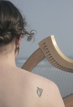 I can't wait to get my own little harp tattoo, but it will be an orchestral harp design and not a celtic. ;)