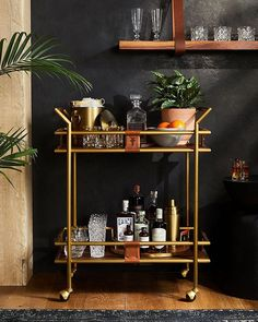 bar cart styling We just raised the bar(ware). Cheers to the first home collection from thefryecompany, detailed with brushed brass, rich wood and the brands signature leather. Shop the exclusive, limited-edition items at the link in bio. Diy Home Bar, Home Bar Decor, Bar Cart Decor, Bars For Home, Mini Bar Salon, Gold Bar Cart, Brass Bar Cart, Bar Cart Styling, First Home