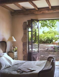double door detail + rustic stone and wood millwork + classical decor in al fresco optional bedroom