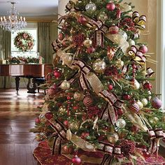 Our Medici Collection shown on a fully decorated tree. I like pairing the elegants of the ornaments with the natural of the leaves in the tree. Frontgate Christmas Trees, Pretty Christmas Trees, Elegant Christmas Decor, Ribbon On Christmas Tree, Christmas Tree Themes, Christmas Traditions, All Things Christmas, Beautiful Christmas, Christmas Wreaths