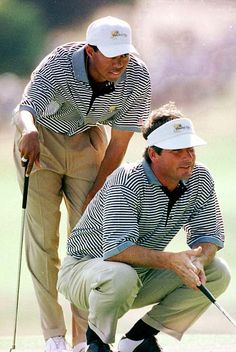 969ac442c62 Fred Couples and Tiger Woods line up a putt in a Presidents Cup match  against the