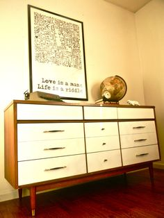Mid-century dresser with painted white drawers. From DIY Confessions.