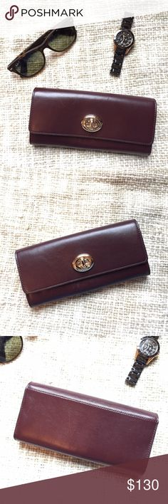 Coach Oxblood Wallet NWOT Beautiful deep burgundy wallet with gold hardware. In unused condition, it just has some super faint scuffs from storage and a small scratch on the closure. Two main compartments with tons of card slots separated by zippered storage with a large slip pocket and another on the back. Big enough to fit my iPhone 6 with room to spare! Coach Bags Wallets