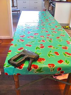 oil cloth + staple gun = cute and functional outdoor table cover!