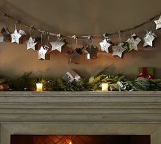 Star Garland Advent Calendar from #potterybarn keeps the surprise inside each star small. Be creative - what will you hide in each day?