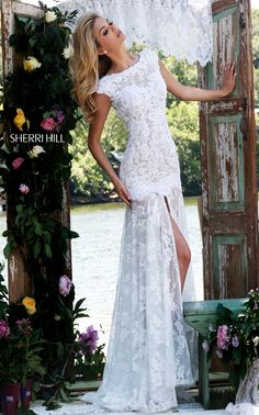Inspired by the catwalk runways, the Sherri Hill 50023 lace prom dress showcases the hottest trend of the sheer long skirt. https://www.pinterest.com/behzadj/jovani-prom-dresses/ and https://www.pinterest.com/behzadj/blush-prom-dresses/ for other awesome prom dresses. The Sherri Hill line is selling out fast.