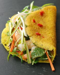 Naturally gluten-free, bánh xèo are simple, savory crepes made from rice flour and coconut milk. Served warm and filled with cool, crisp vegetables, herbs, and drizzled with a spicy-salty sauce, they will blow your mind with flavor and texture achieved with very little effort. Bánh Xèo (Vietnamese Savory Pancakes) Adapted from Plenty by Yotam Ottolenghi...  Continue reading »