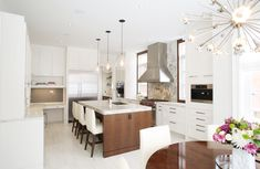 Hollywood Glam kitchen featuring tall windows, tiled floor, mix of paint and stained. Who could ask for more? www.cmidesign.ca #CMID
